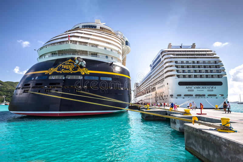 Cruise ships docked in the port of Road Town in Tortola. Road Town, British Virgin Islands - January 05, 2016: Cruise ships MSC Orchestra and Disney Fantasy stock photos