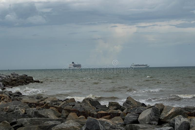 The Cruise ships heading out to sea on a stormy day stock image