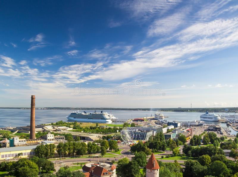 Cruise ships in Tallinn harbor, Estonia. Seaport and ships, aerial view of pier. Panorama of Old Tallinn with Baltic sea and beautiful cloudy blue sky royalty free stock photos