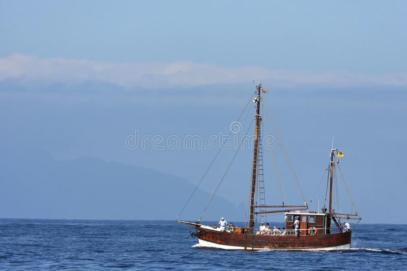 Cruise in Tenerife. March, 29, 2011, An old boat is on a Cruise for whale watching between Tenerife and La Gomera, two of Canary Islands royalty free stock photography