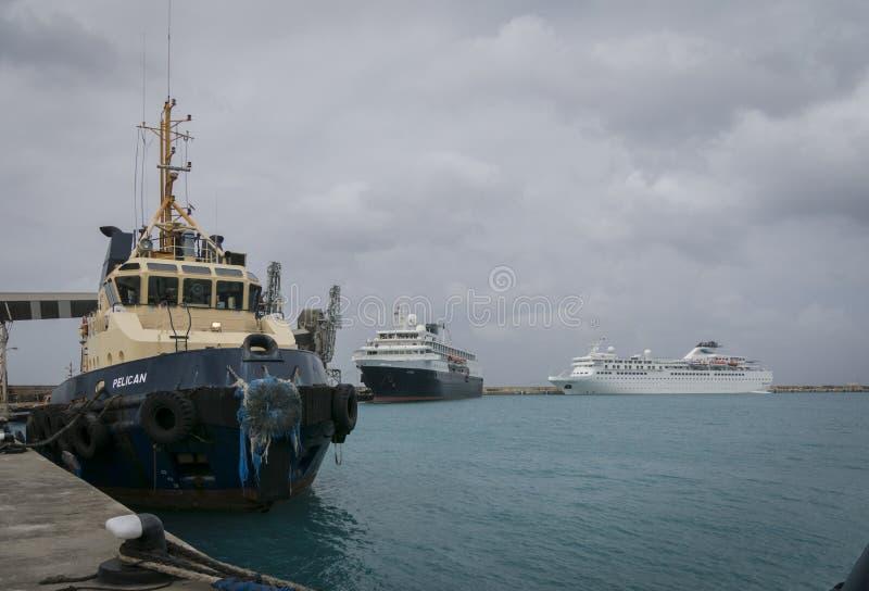 Cruise Terminal in Bridgetown, Barbados. Pilot boat and cruise ships in the terminal at Bridgetown, Barbados royalty free stock image
