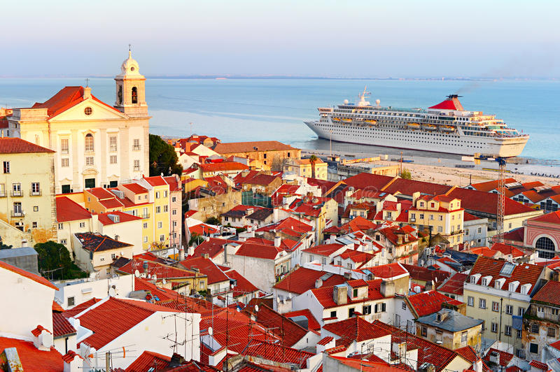 Cruise to Lisbon. Cruise liner in Lisbon harbor at sunset. Portugal stock photography