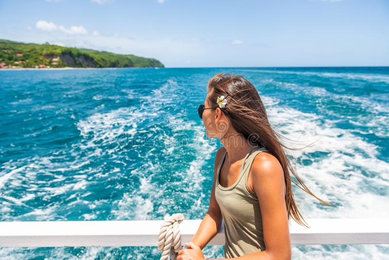 Cruise travel vacation woman relaxing by the water looking at Caribbean sea. St Lucia tourist girl enjoying tropical holidays stock image