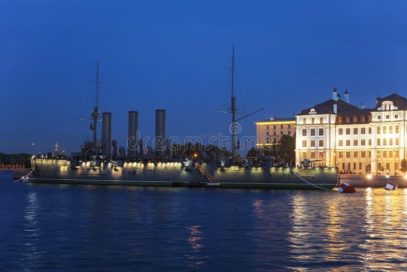 The cruiser `Aurora` at the Petrovskaya embankment during the white nights, Saint-Petersburg, stock image