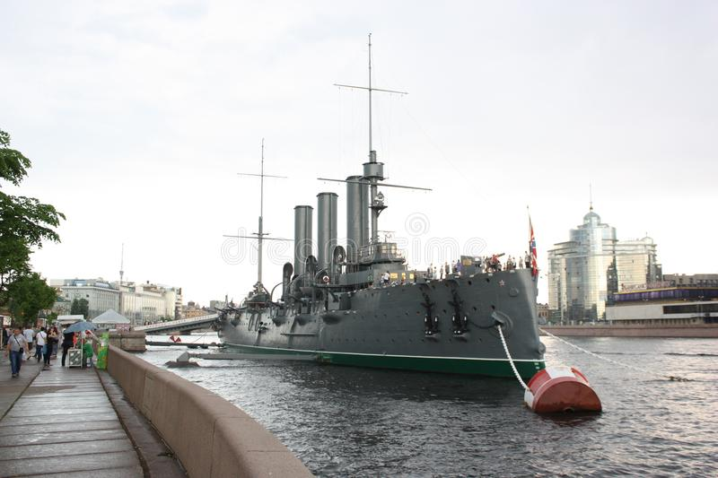 The Cruiser Aurora. Saint-Petersburg. Bulletin of the great October revolution of 1917. Photo cruiser Aurora, standing on the eternal Parking lot on the Neva royalty free stock images