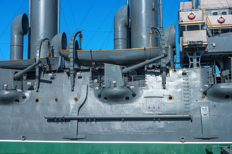 The Cruiser Aurora. St. Petersburg, Russia. Fragment of the side of the ship. You can see the weapon, the lifeboat. The stock image