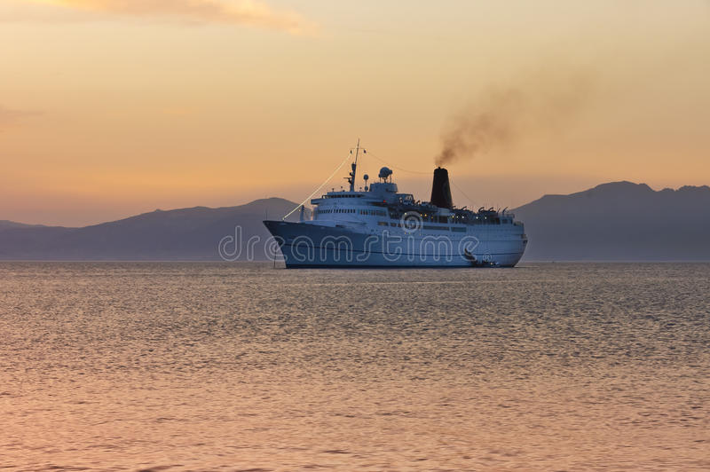 Cruiser ship sailing on Aegean sea stock images