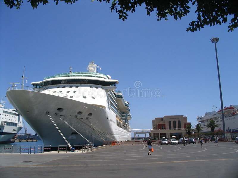 Cruiseship in seaport stock photos