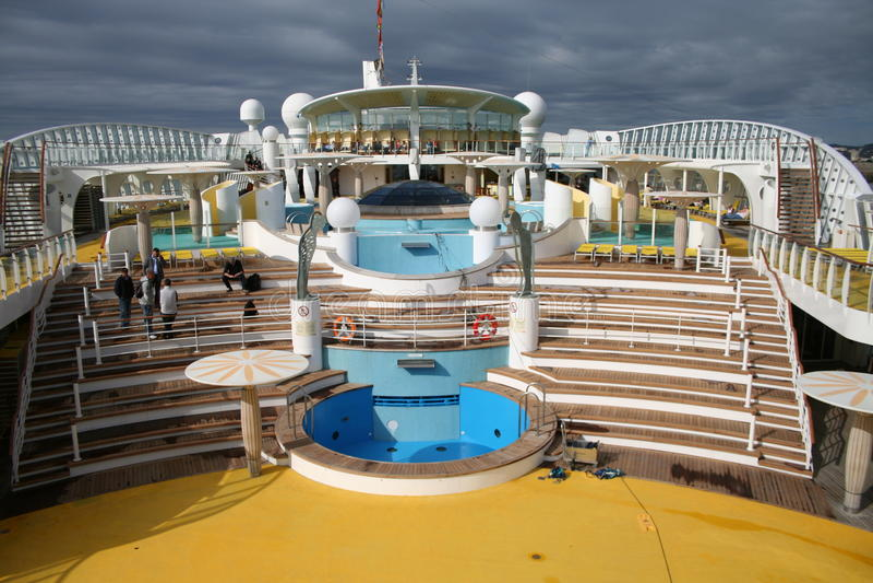 Cruiseship Swimming Pool. Outdoor Pool of AIDA Diva Cruiseship on deck 10: Sunchairs, pool area, bar stock photos