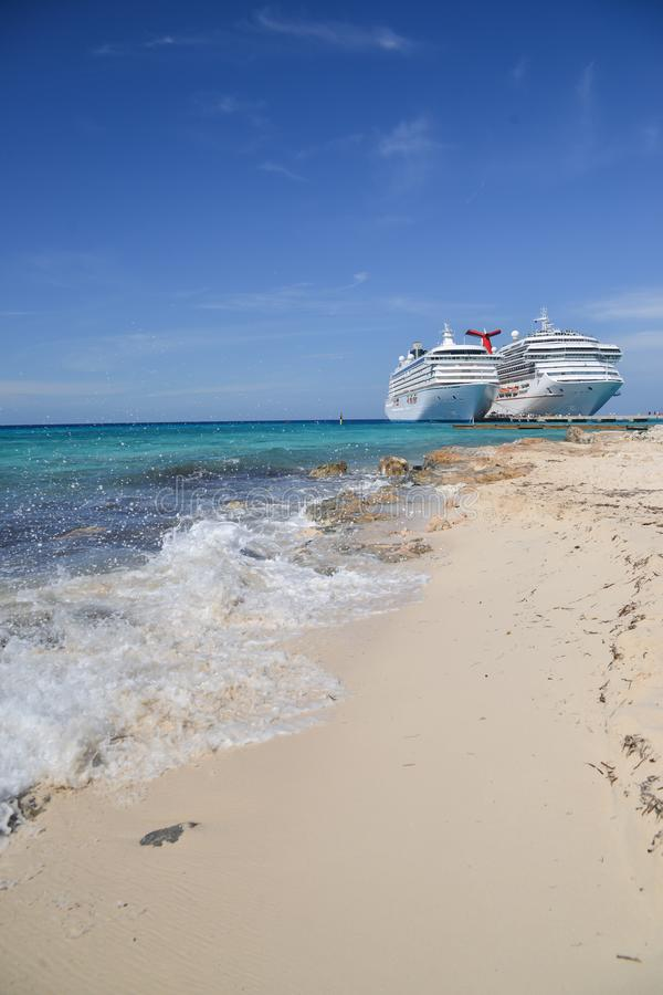 Cruising away on a summers day. Two cruise ships docked on a summers day at a tropical island stock photos