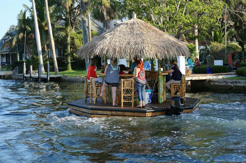 Cruising and boozing tiki bar going down the New River in Fort Lauderdale. stock image