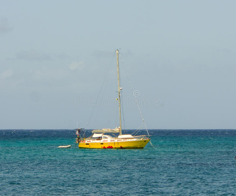 A cruising yacht anchored at lower bay, bequia royalty free stock photography