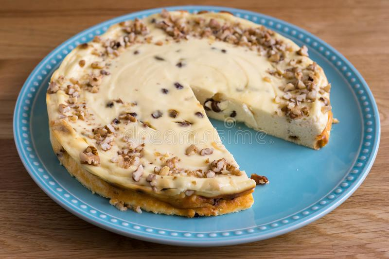 Crumble and Nut Cheesecake on a plate stock images