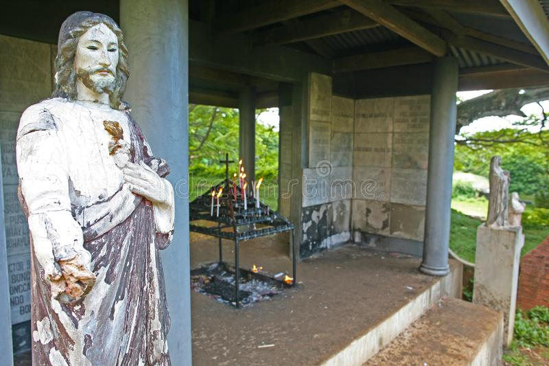 A crumbling jesus christ welcomes worshippers to an active Catholic shrine on the island of Siquijor in the Philippines royalty free stock images