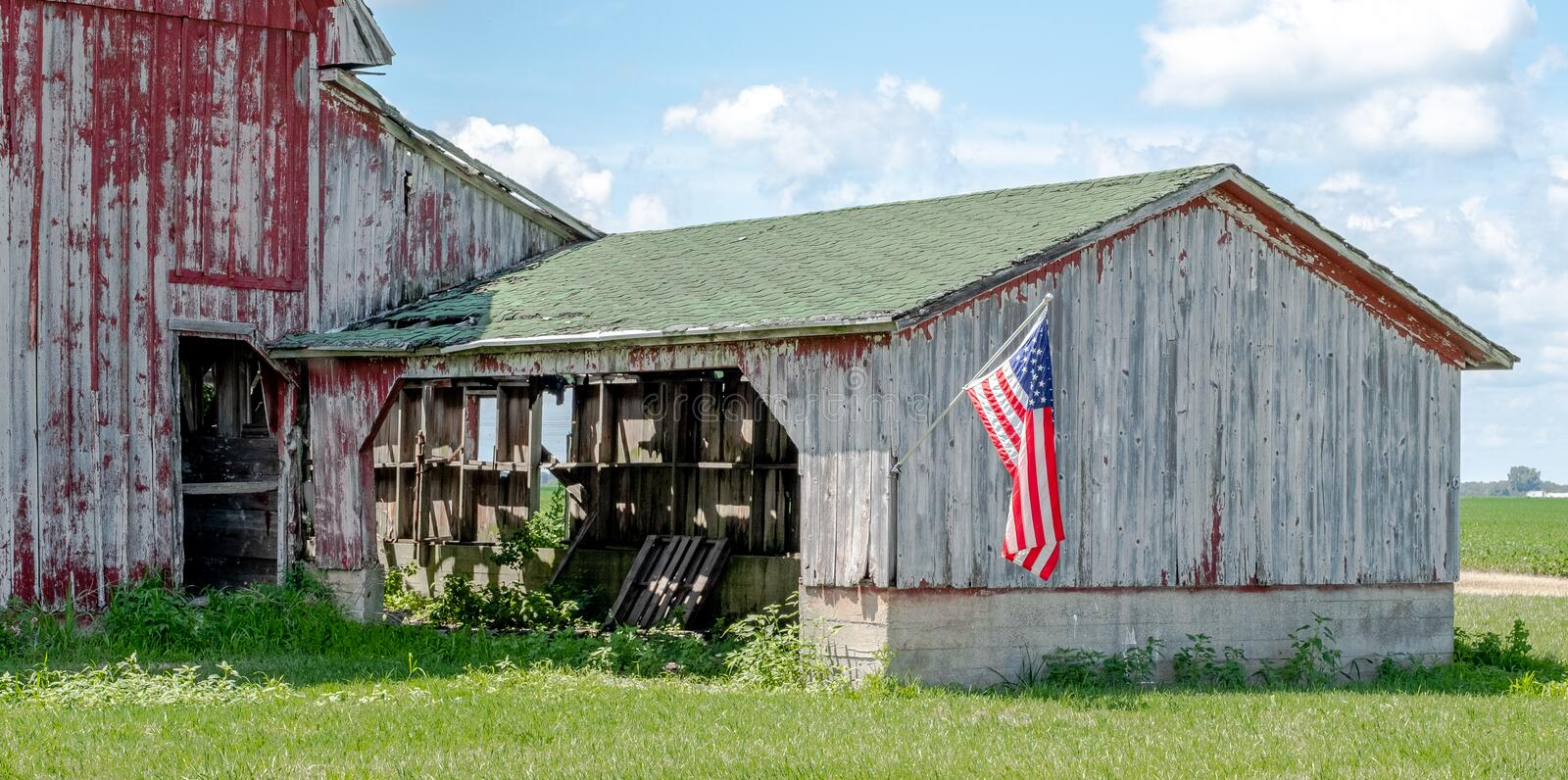 Crumbling Old Barn With American Flag royalty free stock photography