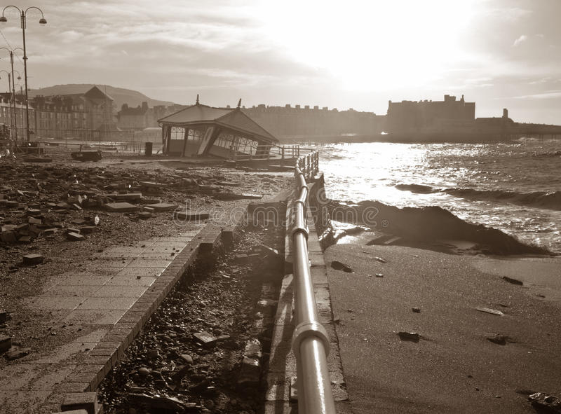 Crumbling shelter after storms. The state of Aberystwyth seafront after winter storms with a shelter fallen through the stone promenade royalty free stock photo