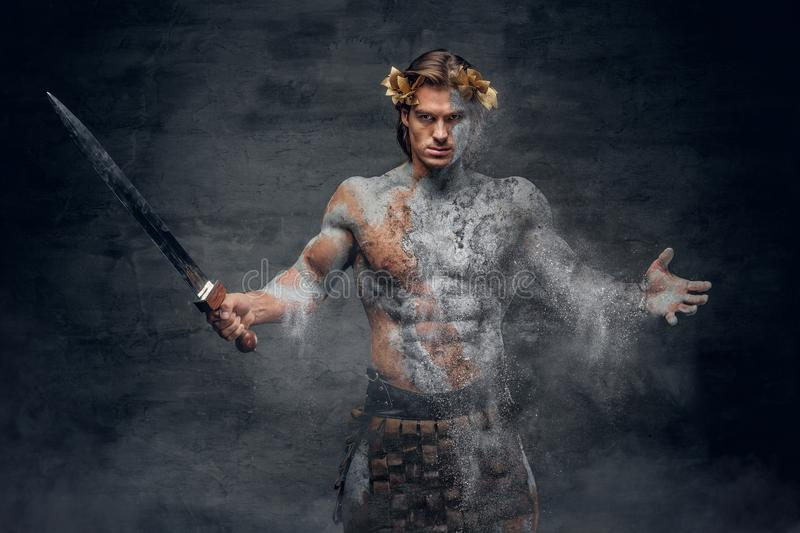Ancient male athletic warrior with sword. royalty free stock photos