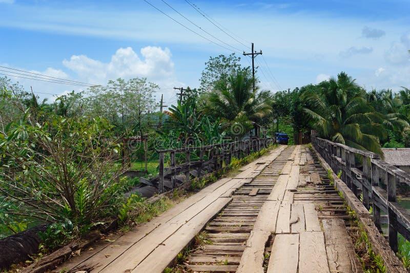 Crumbling tropical bridge stock photos