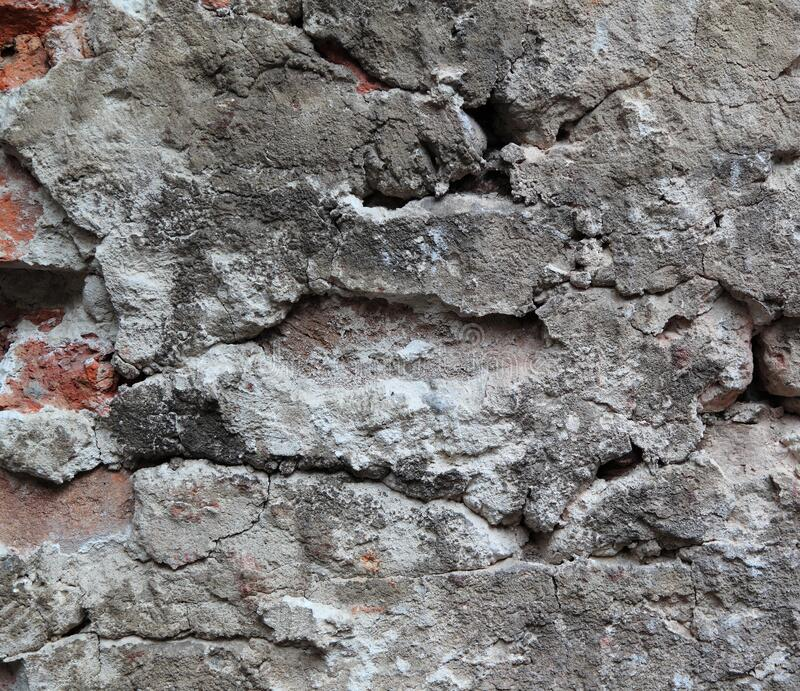 Crumbling Wall. An old crumbling wall forms an irregular pattern that can be used for backgrounds royalty free stock images