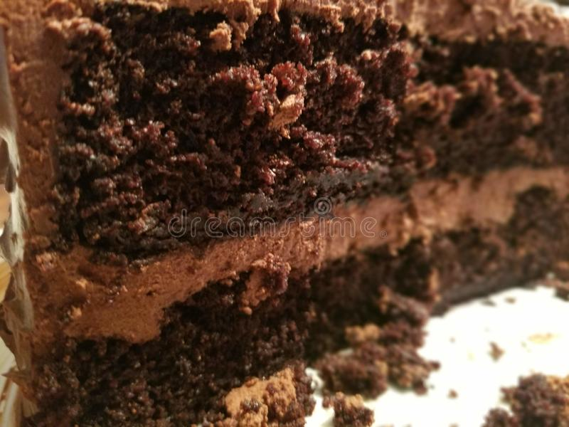 Crumbly chocolate cake. Icing, dessert stock images