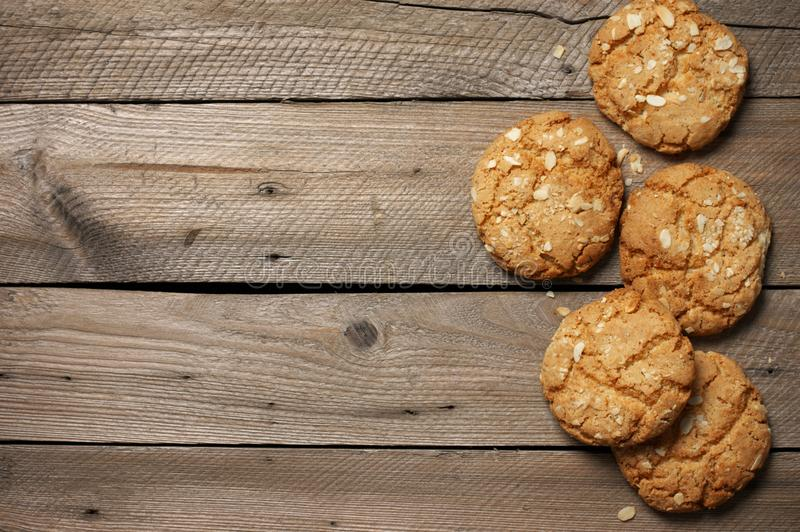 Crumbly peanut cookies on wood. Crumbly peanut cookies as border on rustic wooden background. Top view royalty free stock images