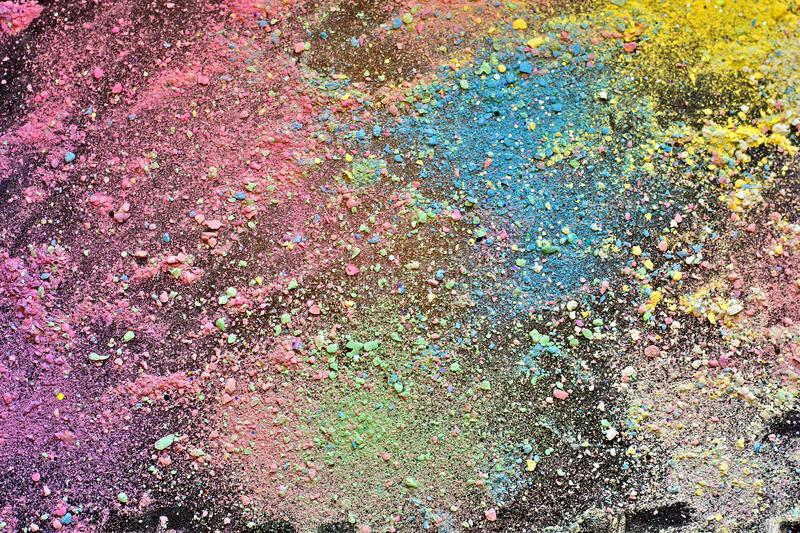 Crumbs of chalk colorful background royalty free stock photo