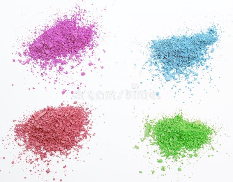 Crumbs geïsoleerd kleuren kosmetisch poeder stock foto's