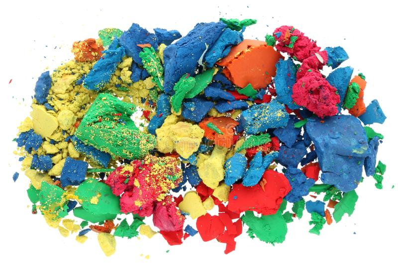 The crumbs of the multi-colored dry gouache paint lie a pile on royalty free stock photos