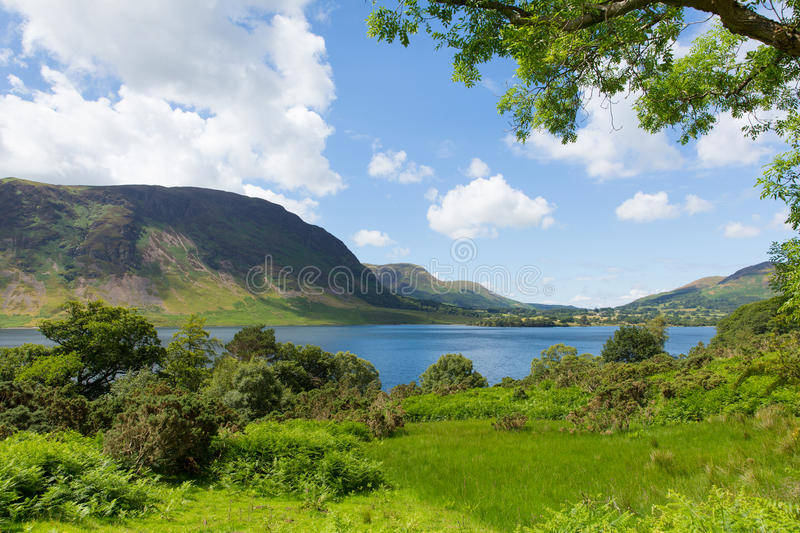 Crummock Water Lake District North West England UK between Buttermere and Loweswater. On summer day with blue sky and white clouds stock photos