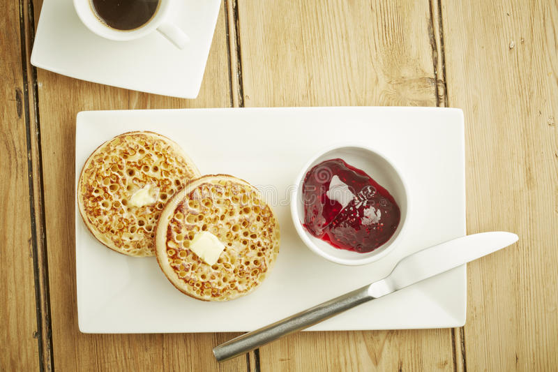 Crumpets toasted on white dish stock photography