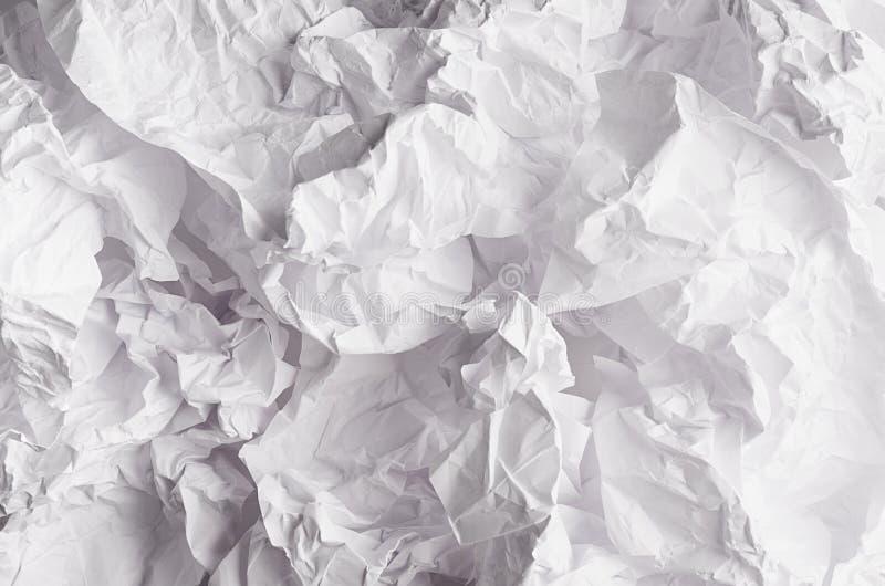 Crumpled сморщило волнистую серую бумажную текстуру, абстрактную предпосылку полигона стоковое изображение