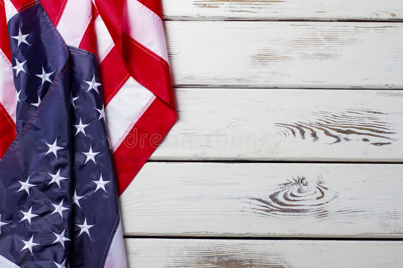 Crumpled American flag. American flag on wooden background. Banner laying on white table. Democracy and freedom stock photos