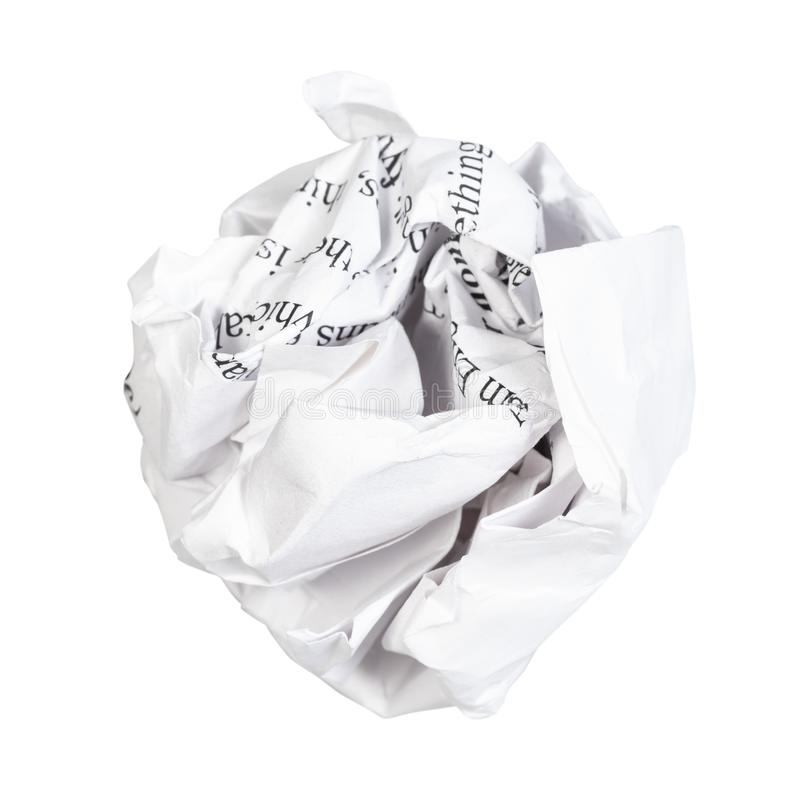 Crumpled ball from written paper cut out on white. Background stock image
