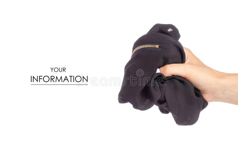 Crumpled black T-shirt in hand clothes fabric zipper pattern. On white background isolation royalty free stock photos