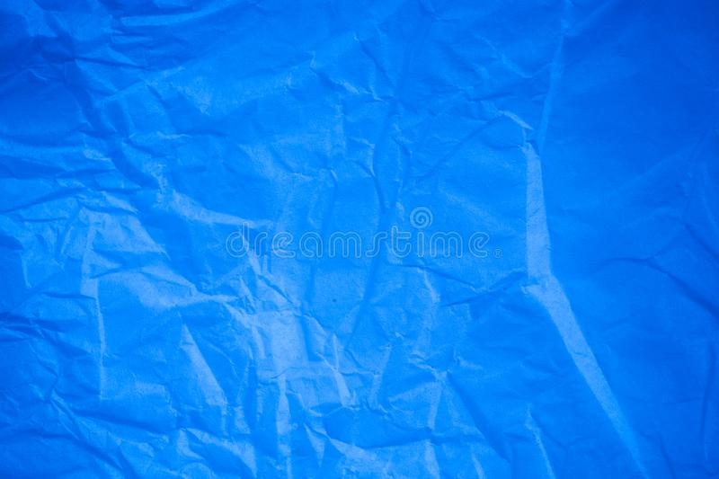 Crumpled blue paper background. Crumpled blue paper a background stock illustration
