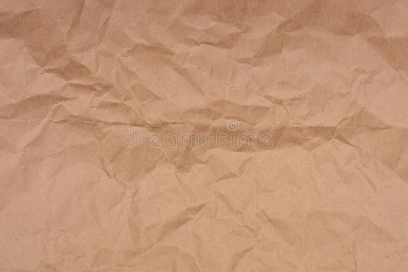 The crumpled brown kraft paper royalty free stock photo