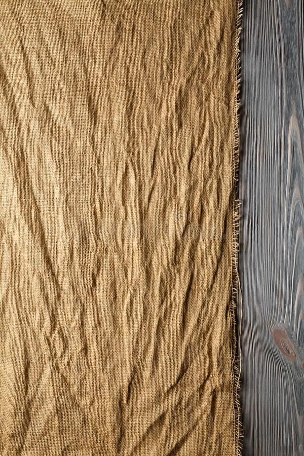 Crumpled canvas material on wooden planks background royalty free stock photos