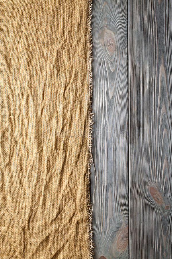 Crumpled canvas material on wooden background stock photos