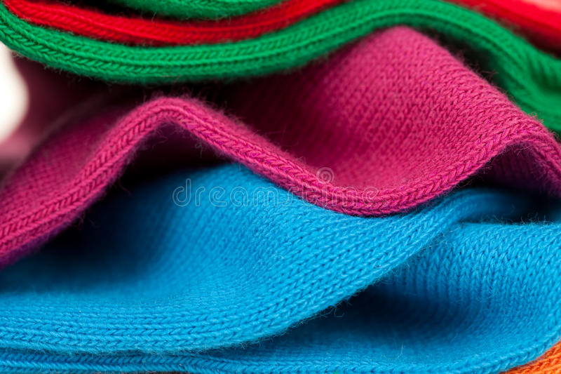 Crumpled colorful clothes close-up. Crumpled textile fabric colorful clothes close-up royalty free stock image