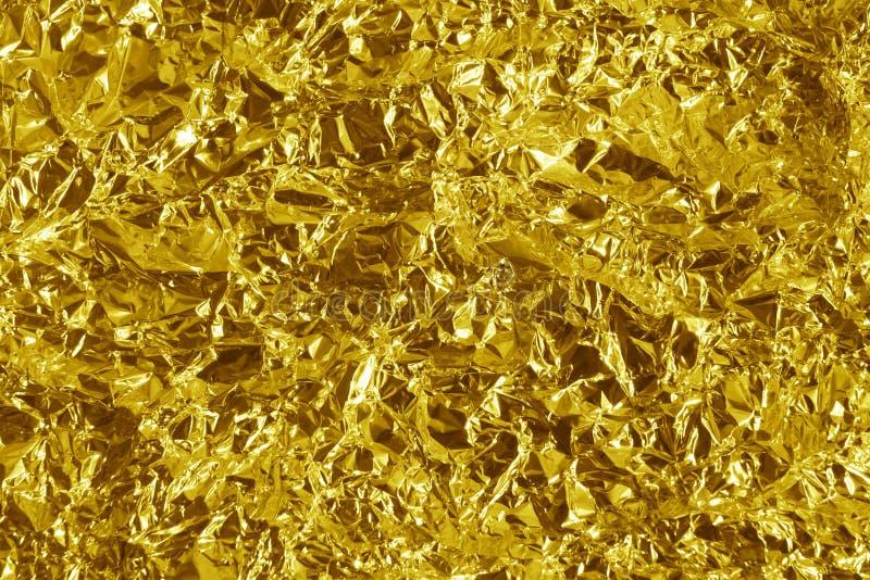 Crumpled gold metal stock photography