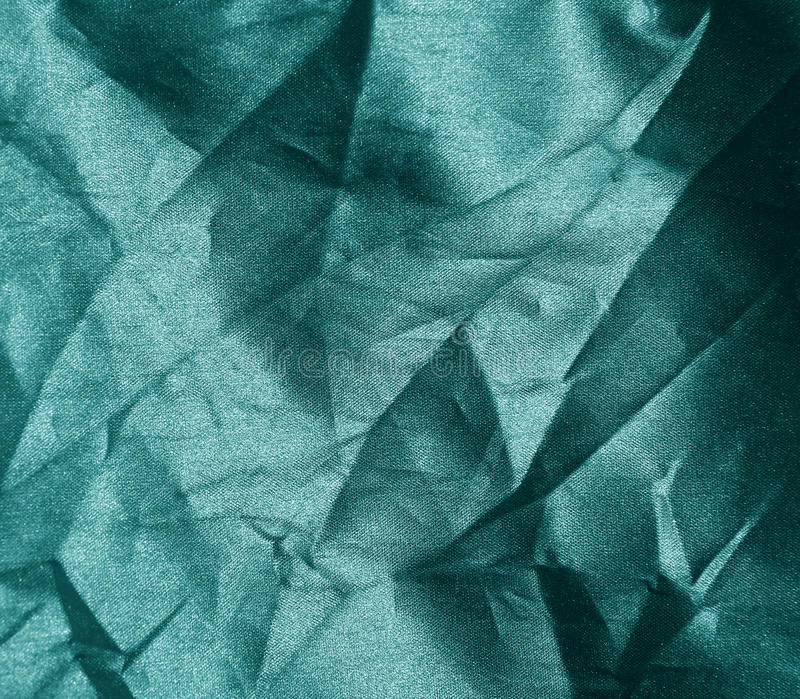 Crumpled green fabric texture royalty free stock photography