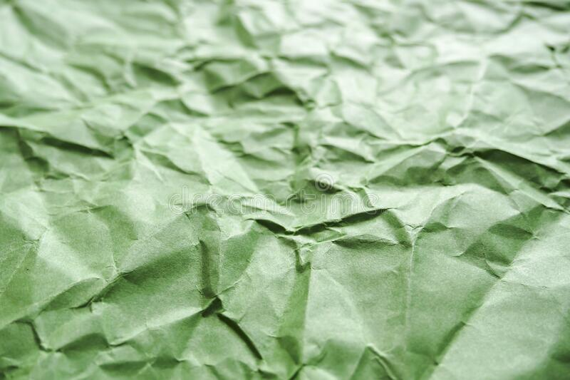 Crumpled green paper, abstract background, selective focus.  stock images
