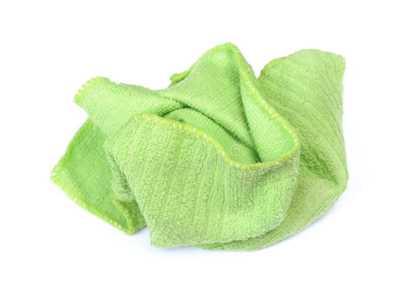 Crumpled green rag. Isolated on white background stock photography
