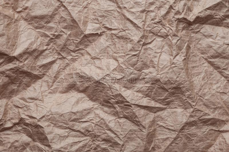 Crumpled kraft paper. Texture crumpled recycled old brown paper royalty free stock photography