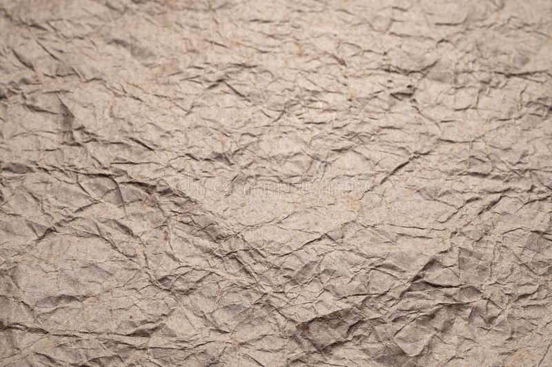 Crumpled kraft paper. Texture crumpled recycled old paper royalty free stock photos