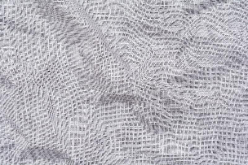 Crumpled light gray linen fabric background, close up.  royalty free stock images