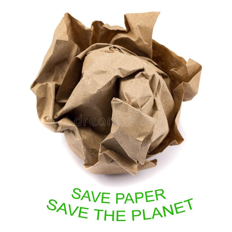 Forest conservation concept. Crumpled into a lump craft paper isolated on white background with inscription save paper save the forest, forest conservation royalty free stock image
