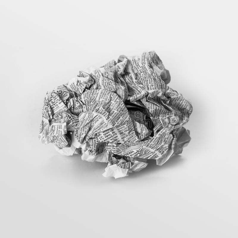Crumpled newspaper. Isolated over gray background stock photo
