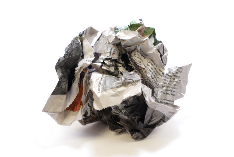 Crumpled newspaper. Isolated over white background with light shadows royalty free stock photo