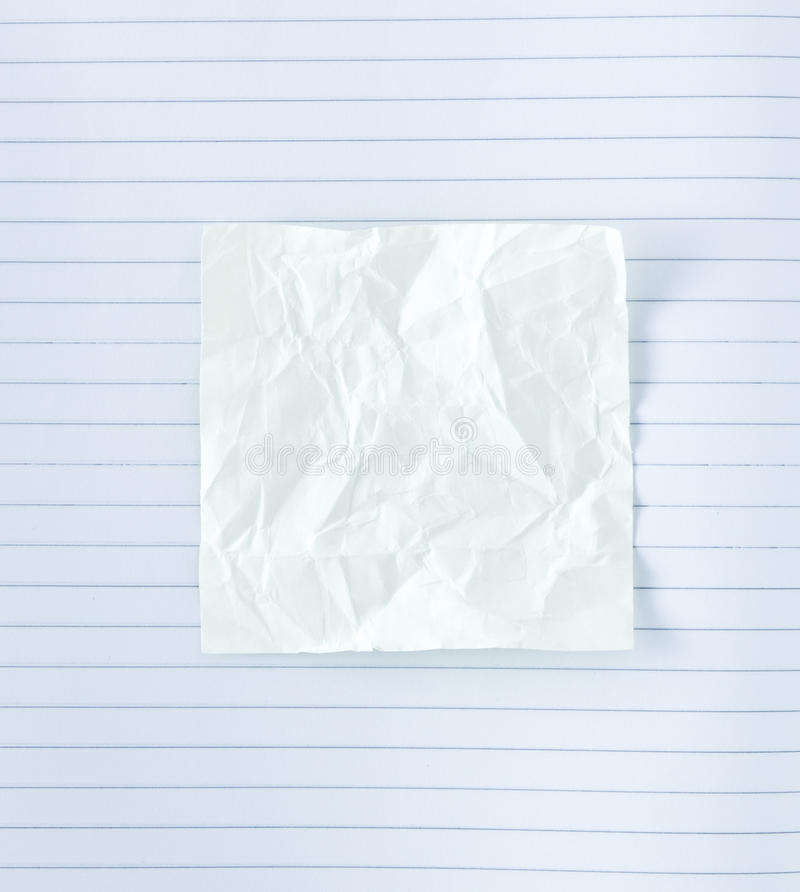 Crumpled Notepad On Paper Lines Stock Photo